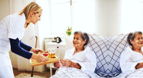 a caregiver woman serving an elderly woman