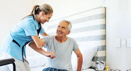 a caregiver woman with an elderly man
