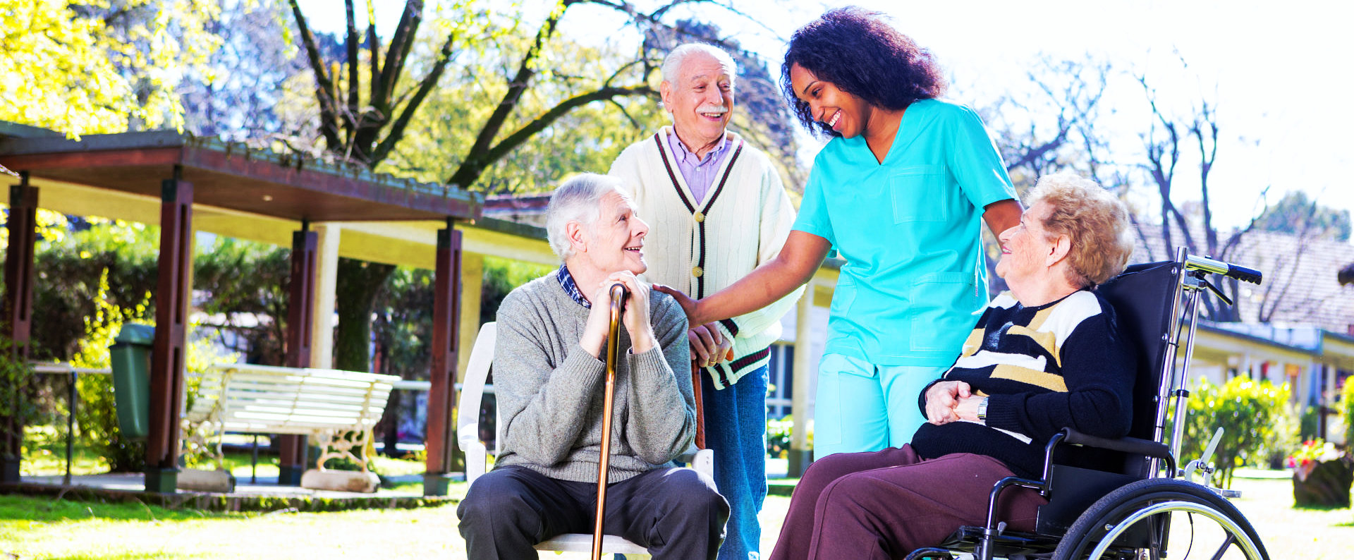three elderly people with a female caregiver